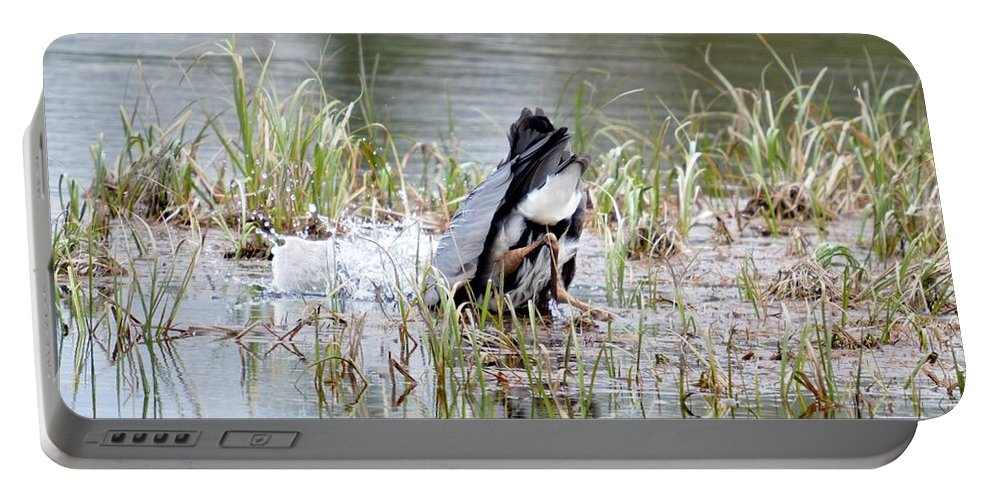 Great Blue Heron Portable Battery Charger featuring the photograph The Strike by Thomas Phillips