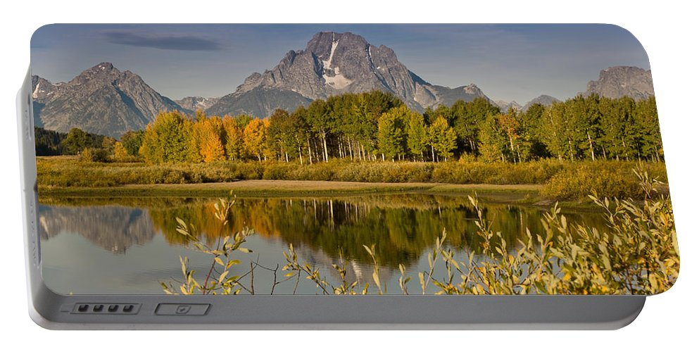 Aspen Portable Battery Charger featuring the photograph The Tetons And Fall Colors by Jeff Goulden