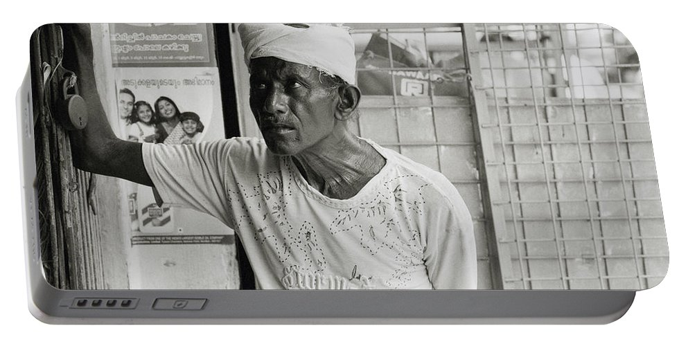 Worker Portable Battery Charger featuring the photograph The Worker In Cochin by Shaun Higson