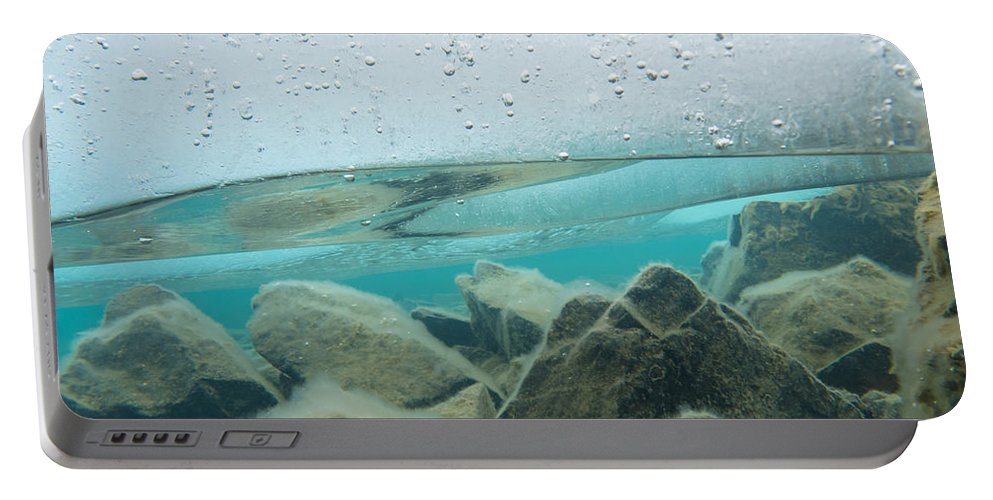 Above Portable Battery Charger featuring the photograph Thick Ice Sheet Underwater Over Rocky Lake Bottom by Stephan Pietzko