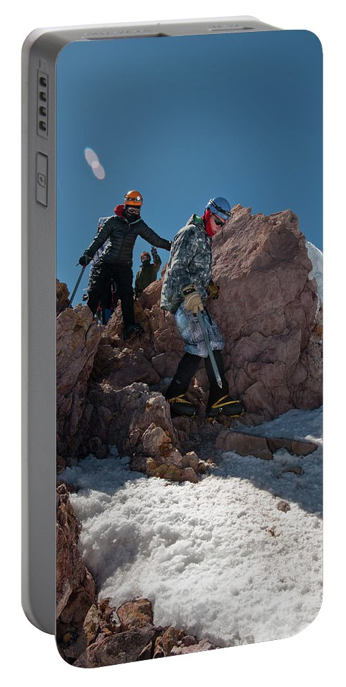 Young Man Portable Battery Charger featuring the photograph Three People Climb Down Rocks by Beth Wald