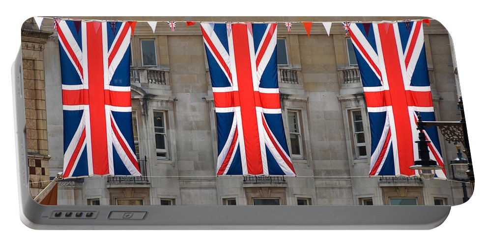 Red Portable Battery Charger featuring the photograph Three Union Jack Flags by Dutourdumonde Photography