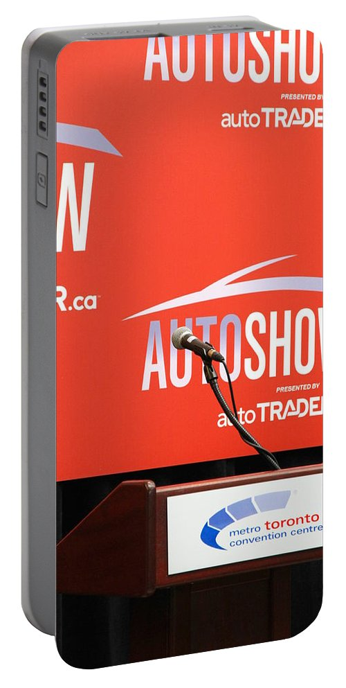 Press Portable Battery Charger featuring the photograph Toronto Autoshow by Valentino Visentini