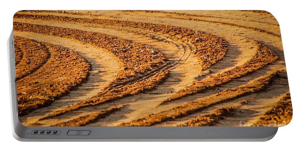 Tractor Tracks Portable Battery Charger featuring the photograph Tractor Tracks by Grace Grogan