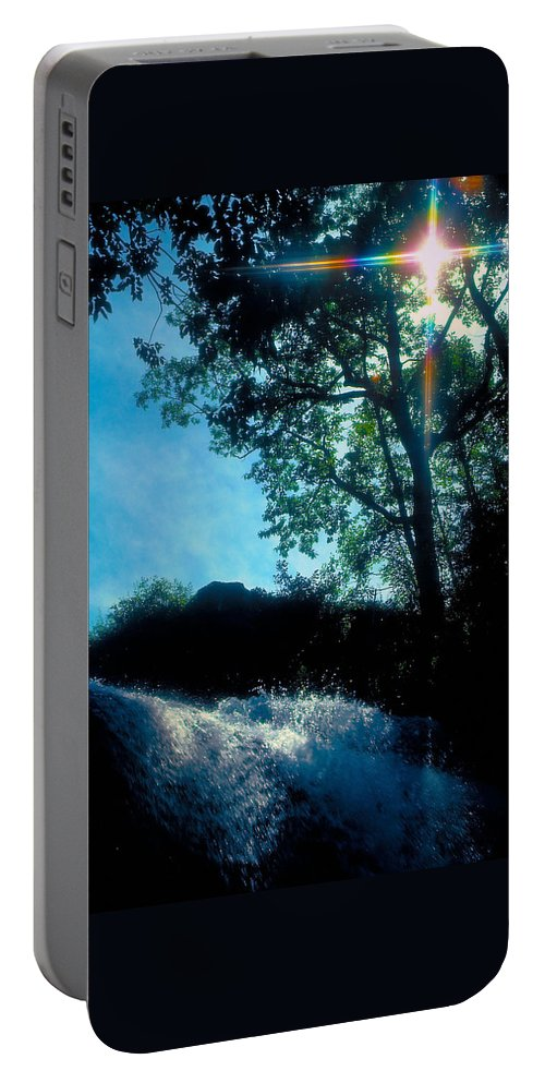 Waterfall Portable Battery Charger featuring the photograph Tree Planted By Streams Of Water by Marie Hicks