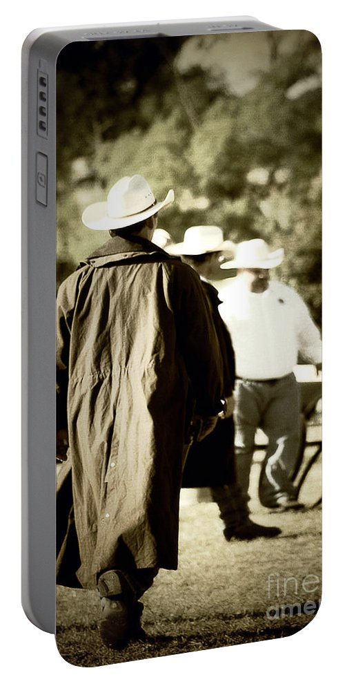 Country Portable Battery Charger featuring the photograph Trenchcoat Cowboy by Trish Mistric