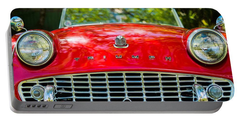 1960s Portable Battery Charger featuring the photograph Triumph Tr3 by Raul Rodriguez
