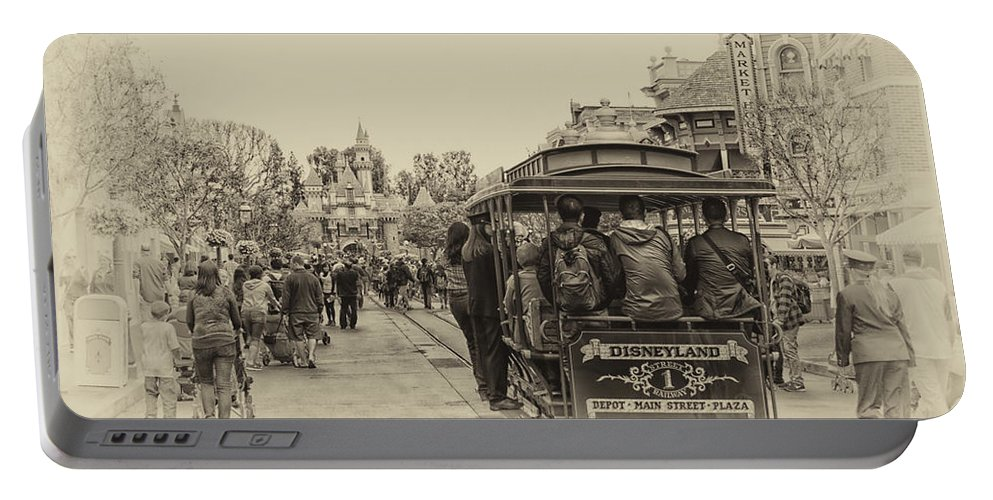 Disney Portable Battery Charger featuring the photograph Trolley Car Main Street Disneyland Heirloom by Thomas Woolworth