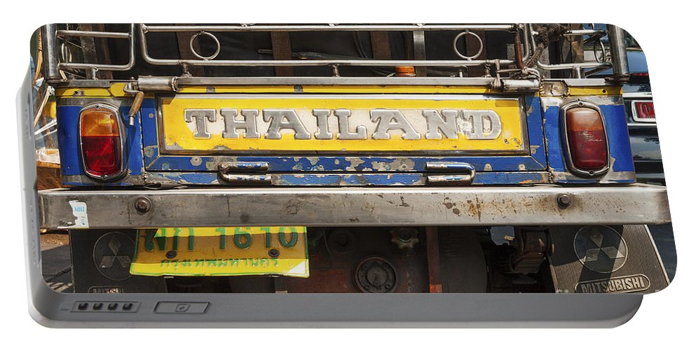 Adapted Portable Battery Charger featuring the photograph Tuk Tuk Taxi In Bangkok Thailand by Jacek Malipan