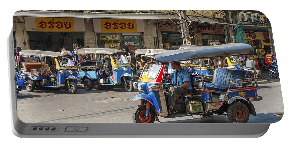 Adapted Portable Battery Charger featuring the photograph Tuk Tuk Taxis In Bangkok Thailand by Jacek Malipan