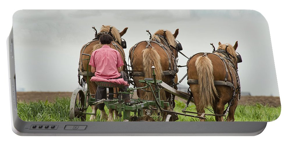 Amish Portable Battery Charger featuring the photograph Turning The Earth by David Arment