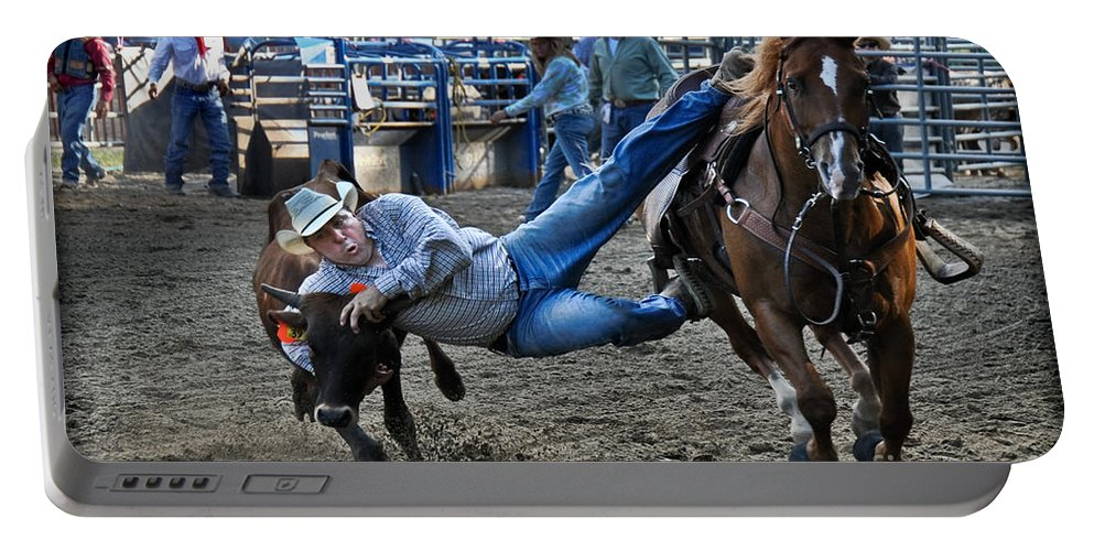 Cowboy Portable Battery Charger featuring the photograph Twisting Horns by Gary Keesler