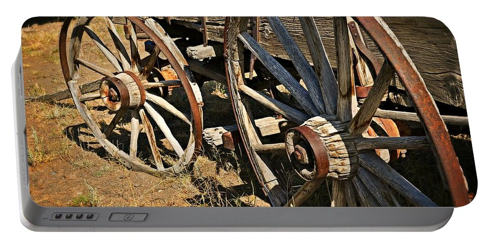 Wagon Portable Battery Charger featuring the photograph Unequal Wheels by Marty Koch