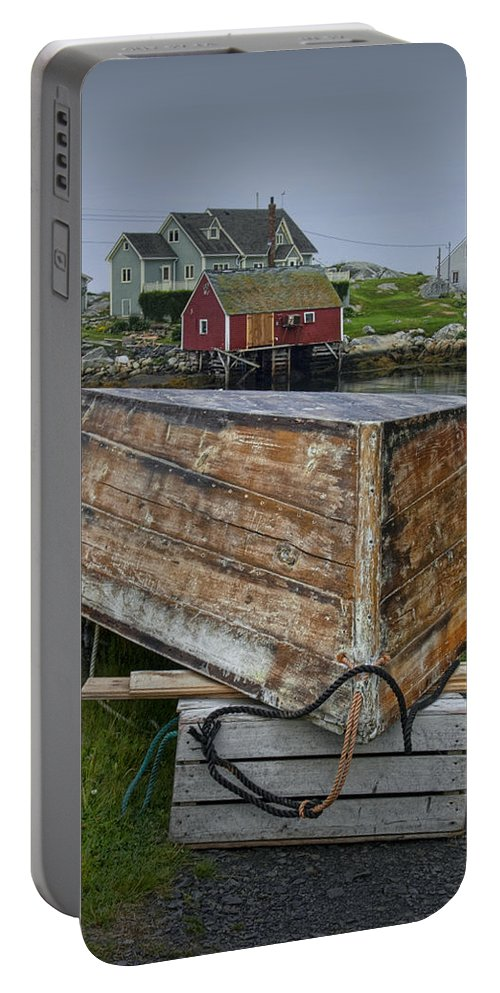 Harbour Portable Battery Charger featuring the photograph Upside Down Boat In Peggy's Cove Harbour by Randall Nyhof