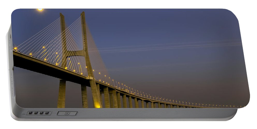 Vasco Portable Battery Charger featuring the photograph Vasco Da Gama Bridge In The Moonlight by Alexandre Martins