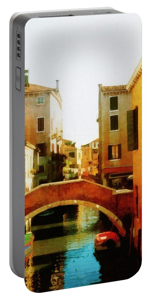 Venice Portable Battery Charger featuring the photograph Venice Italy Canal With Boats And Laundry by Michelle Calkins