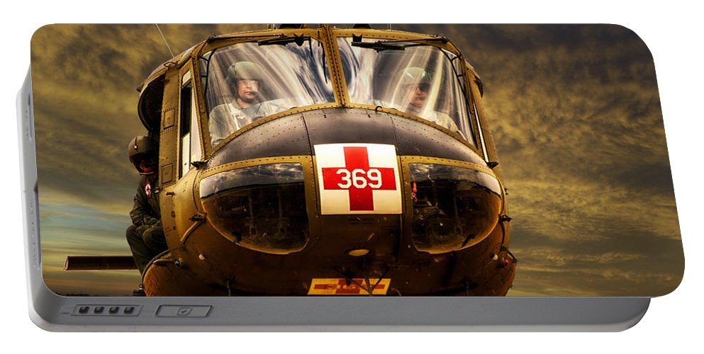 Dust Off Portable Battery Charger featuring the photograph Vietnam Era Medivac 369 Helicopter by Thomas Woolworth