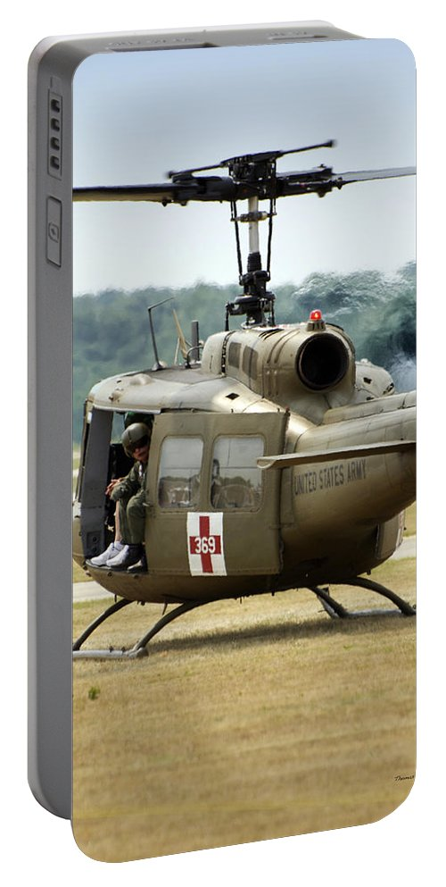 Dust Off Portable Battery Charger featuring the photograph Vietnam Medevac Copter 369 by Thomas Woolworth