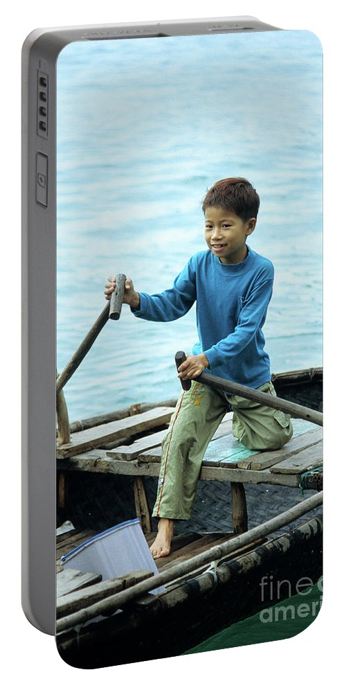 Vietnam Portable Battery Charger featuring the photograph Vietnamese Boy by Rick Piper Photography
