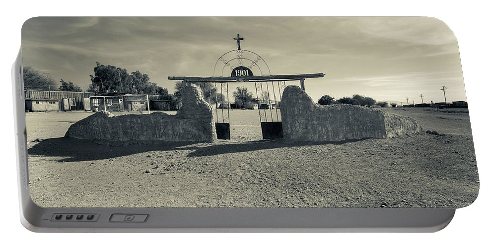 Photography Portable Battery Charger featuring the photograph View Of Abandoned Church Gate by Panoramic Images