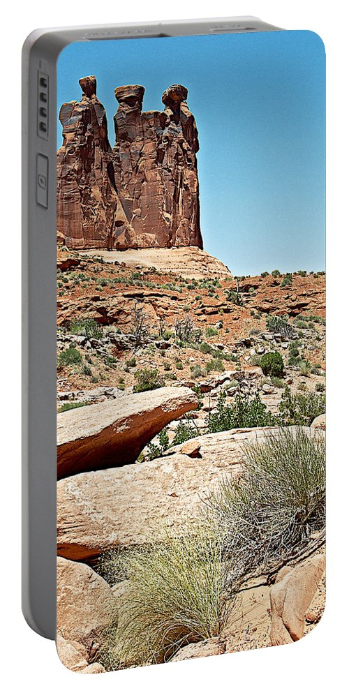 View Of Three Gossips From Park Avenue Trail In Arches Np Portable Battery Charger featuring the photograph View Of Three Gossips In Arches Np-ut by Ruth Hager