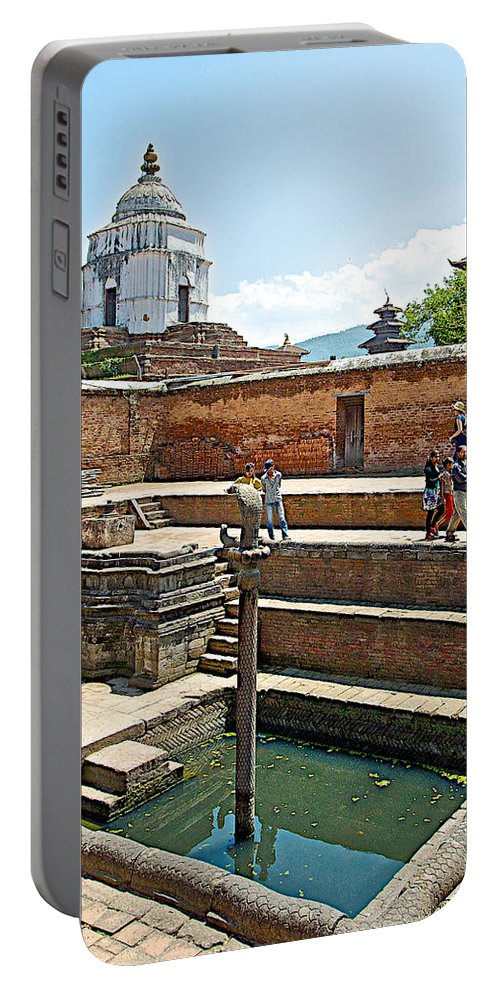 View Of White Temple From Pool Area Behind Bhaktapur Durbar Square In Bhaktapur-nepal Portable Battery Charger featuring the photograph View Of White Temple From Pool Area Behind Bhaktapur Durbar Square In Bhaktapur-nepal - by Ruth Hager
