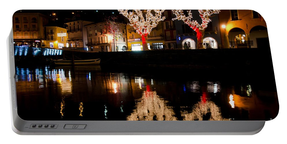 Village Portable Battery Charger featuring the photograph Village Reflected In The Water by Mats Silvan