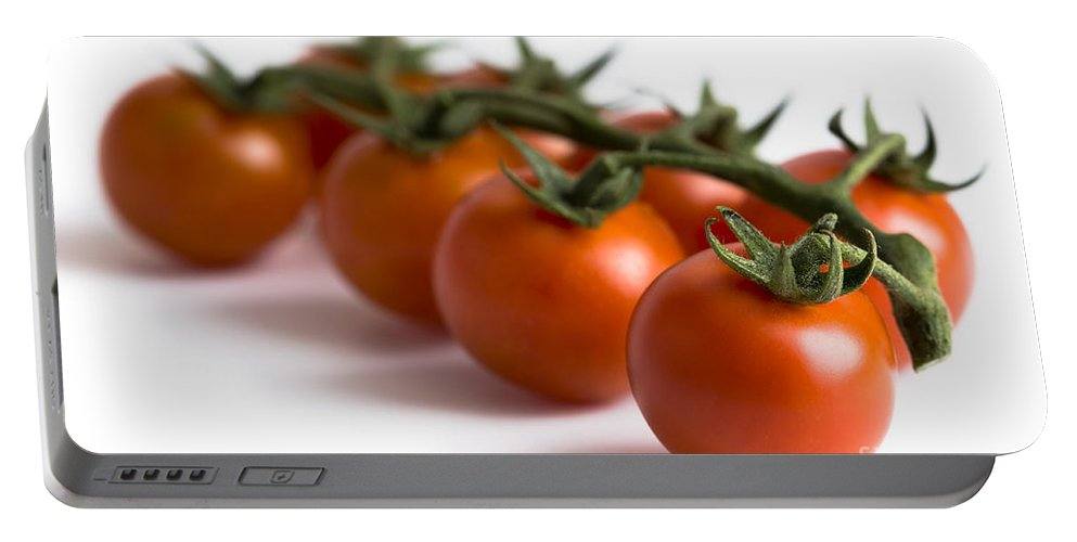Tomatoes Portable Battery Charger featuring the photograph Vine Cherry Tomatoes by Lee Avison