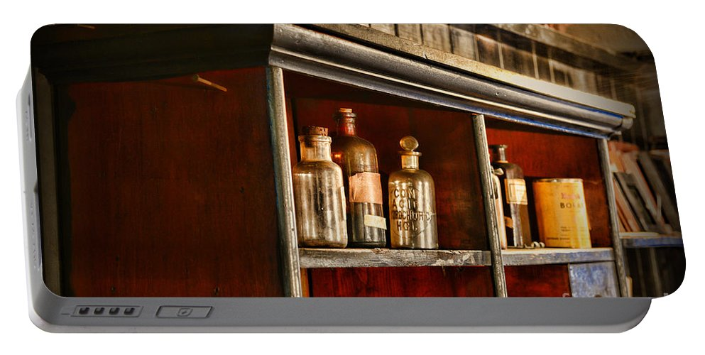 Paul Ward Portable Battery Charger featuring the photograph Vintage Druggist Shelf by Paul Ward