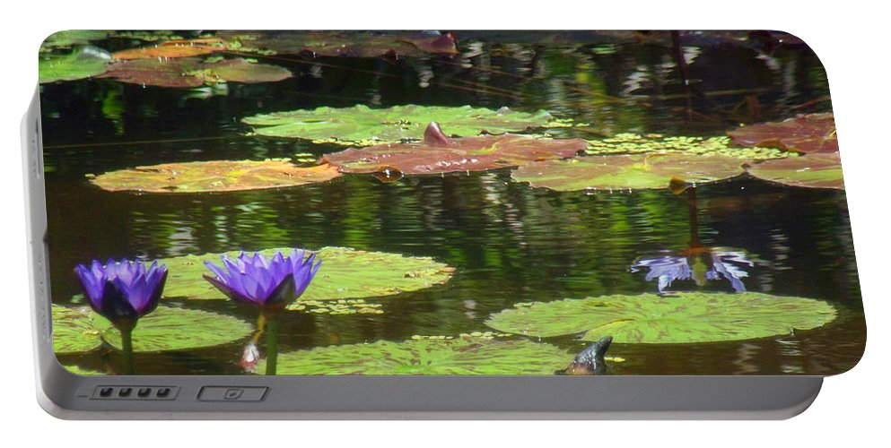 Purple Portable Battery Charger featuring the photograph Water Lily Garden 2 by Jennifer Lavigne