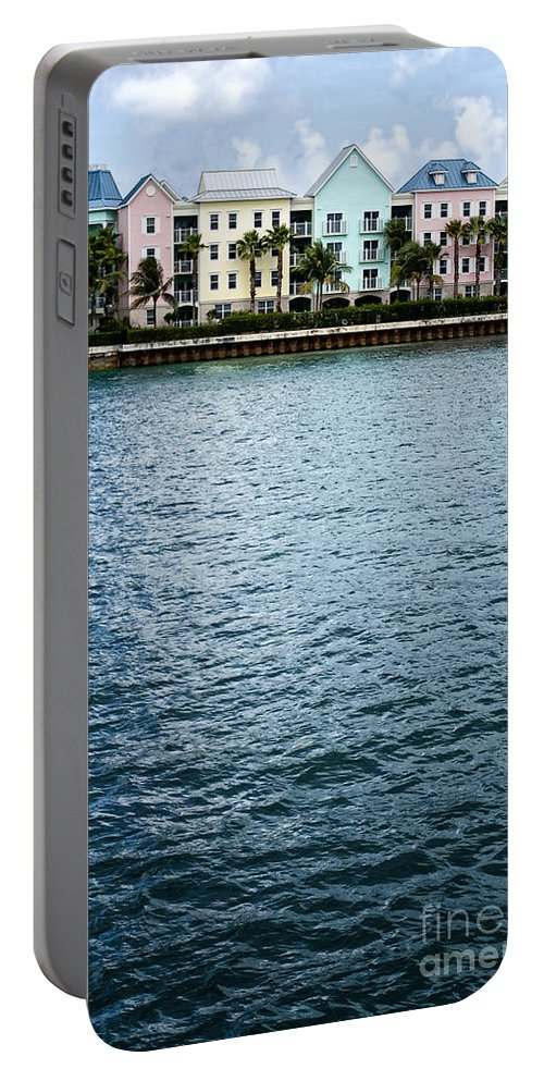 House; Condo; Townhome; Water; Shallow; Island; Tropical; Shore; Waterfront; Bahamas; Blue; Sky; Clouds; Trees; Buildings; Colors; Colorful; Pink; Yellow; Green; Festive; Palm Trees; Outside; Outdoors; Exterior; Home; Tropics; Row Portable Battery Charger featuring the photograph Waterfront Colors by Margie Hurwich