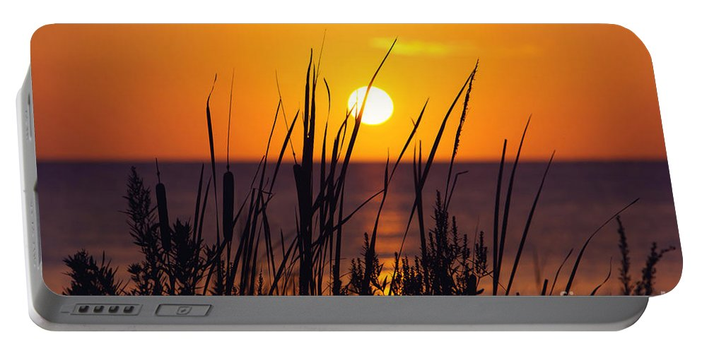 Sunset Portable Battery Charger featuring the photograph Waving Goodby by Joan McCool