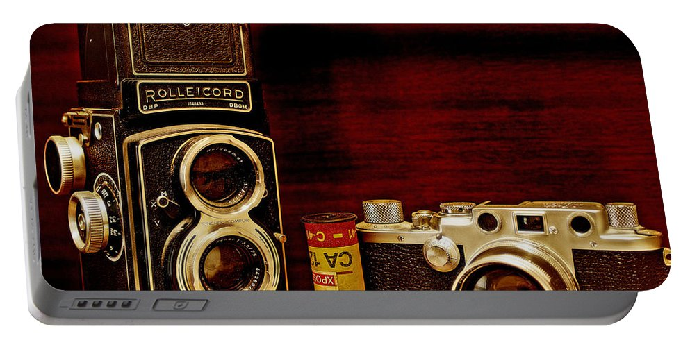 Cameras Portable Battery Charger featuring the photograph When Film Was King by John Anderson