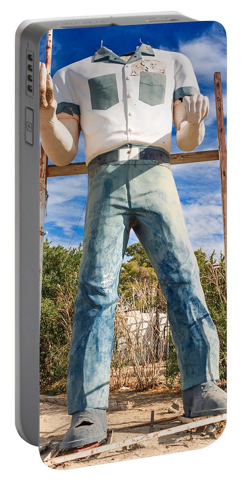 Poor Richards Mini Mart Portable Battery Charger featuring the photograph Whered It Go Muffler Man Statue by Scott Campbell