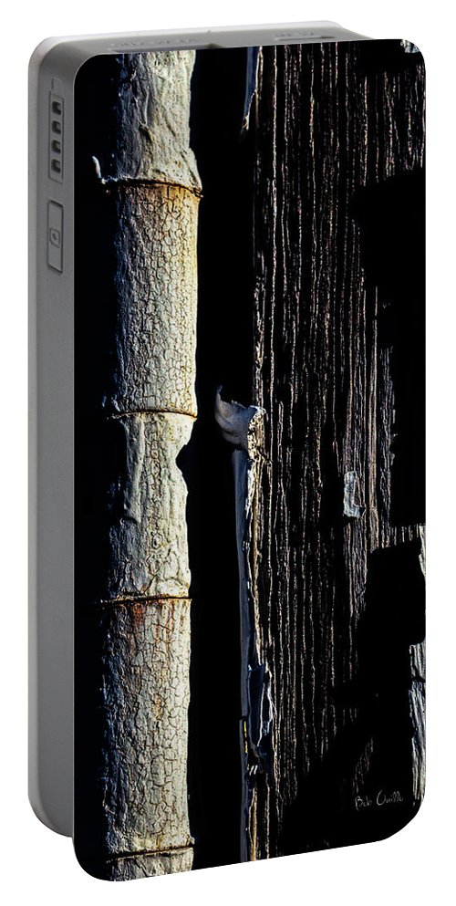 Abstract Portable Battery Charger featuring the photograph White Hinge On The Old Red Barn by Bob Orsillo