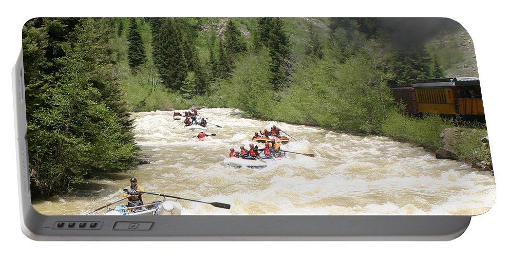 White Water Excitment Along The Animas River Shot From The Durango-silverton Steam Train Portable Battery Charger featuring the photograph Animas River White Water Rafting The by Jack Pumphrey