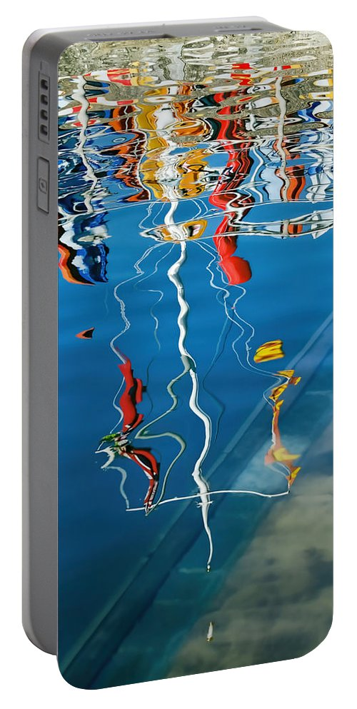 Lyme-regis Portable Battery Charger featuring the photograph Wibbly Wobbly Flagpole Reflections by Susie Peek