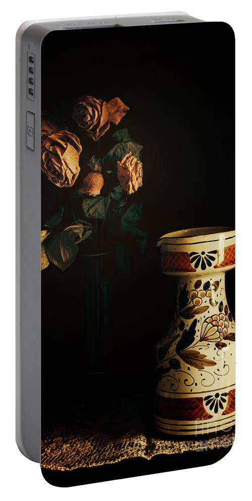 Chiaroscuro Portable Battery Charger featuring the photograph Wilted Roses With Italian Vase by Silvia Ganora