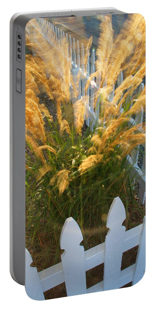Slow Shutter Portable Battery Charger featuring the photograph Wind In The Grass by Mick Anderson