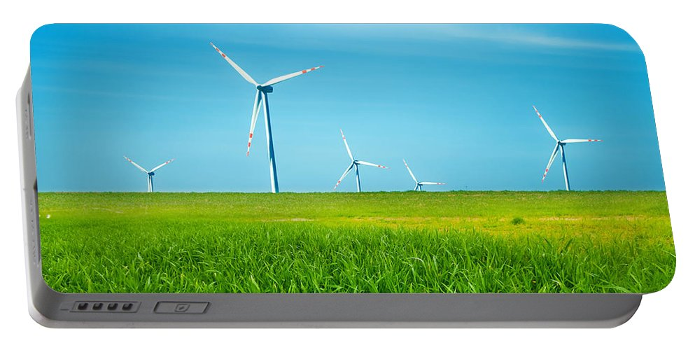 Agriculture Portable Battery Charger featuring the photograph Wind Turbines On Green Field by Michal Bednarek