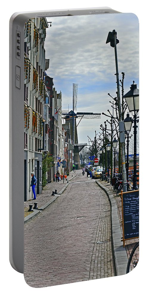 Travel Portable Battery Charger featuring the photograph Windmill At The End Of The Street by Elvis Vaughn
