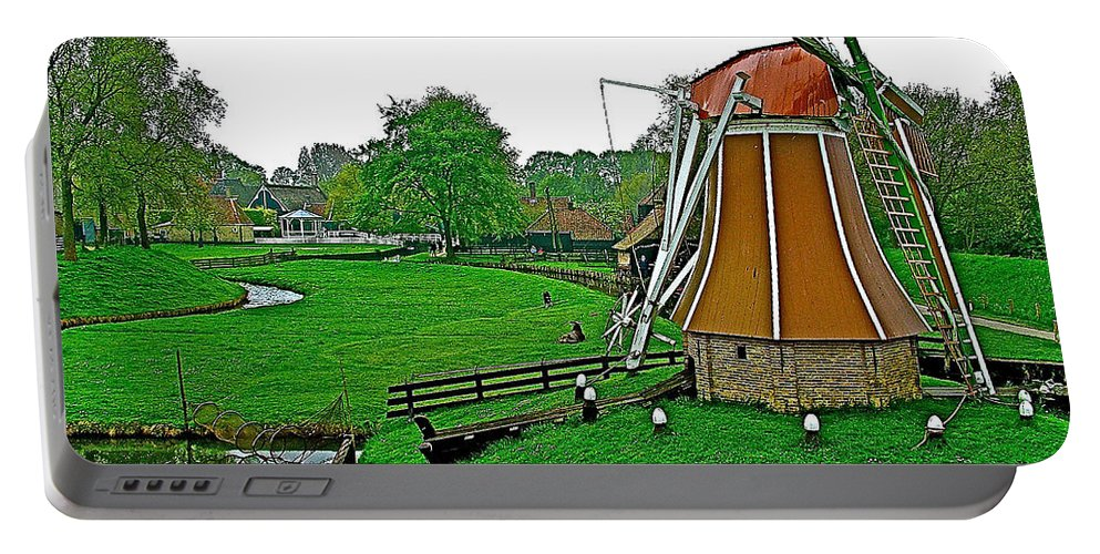 Windmill In A Park In Enkhuizen Portable Battery Charger featuring the photograph Windmill In A Park In Enkhuizen-netherlands by Ruth Hager