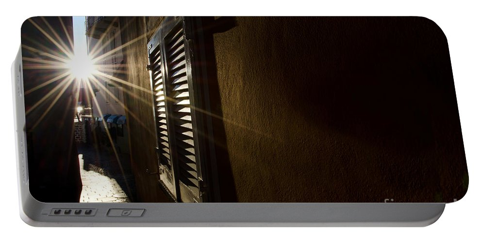 Window Portable Battery Charger featuring the photograph Window In An Alley With Sunlight by Mats Silvan