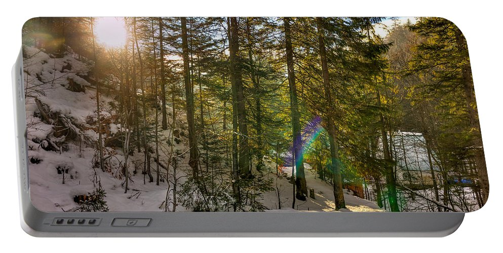 Sun Portable Battery Charger featuring the photograph Winter Sun Flares by Pati Photography