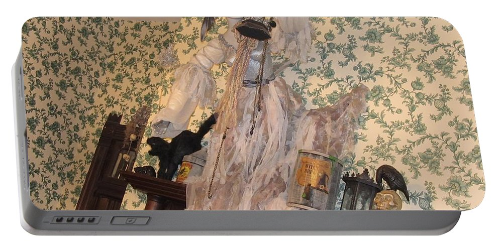 Ghosts Portable Battery Charger featuring the photograph Witch Spirit At The Catfish Plantation Restaurant by Donna Wilson