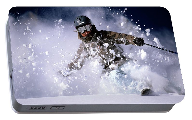 Action Portable Battery Charger featuring the photograph Woman Skiing Powder In The Wasatch by Scott Markewitz