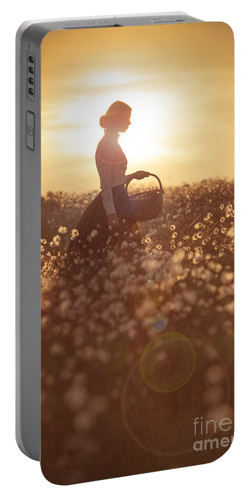 Edwardian Portable Battery Charger featuring the photograph Woman With A Wicker Basket At Sunset by Lee Avison
