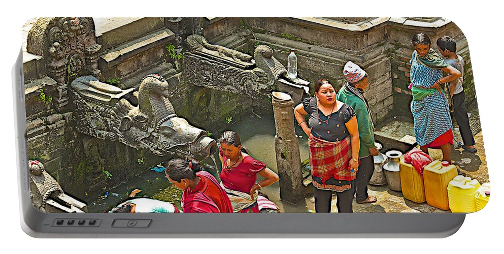 Women Get Bagmati River Holy Water From Ornate Fountains In Patan Durbar Square In Lalitpur In Nepal Portable Battery Charger featuring the photograph Women Get Bagmati River Holy Water From Ornate Fountains In Patan Durbar Square In Lalitpur-nepal by Ruth Hager