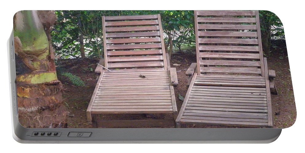 Acrylic Portable Battery Charger featuring the photograph Wooden Beach Chairs by Artist Nandika Dutt