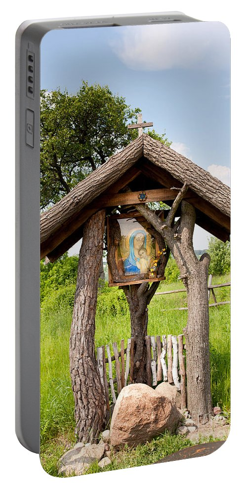 Catholic Portable Battery Charger featuring the photograph wooden shrine of holy Mother in Poland by Arletta Cwalina